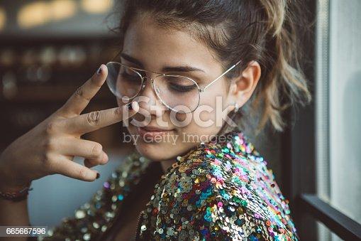 Portrait of a cute teenage girl posing near window.