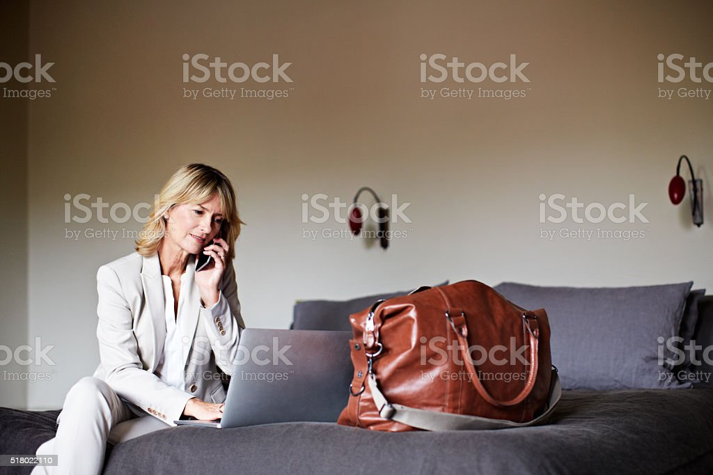I'm at the hotel and online stock photo