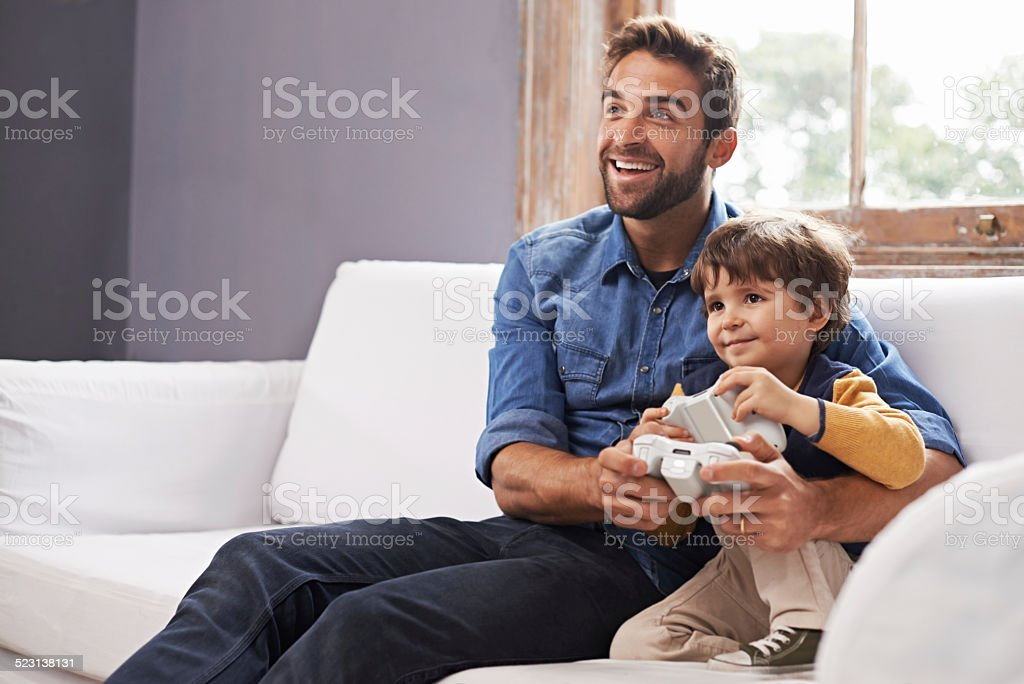 I'm beating you dad!! stock photo
