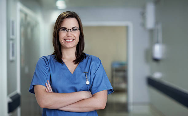 i'm committed to delivering excellent healthcare - female nurse stock photos and pictures