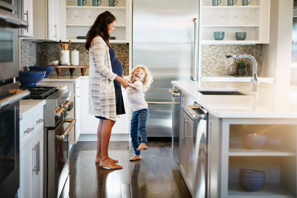 i'm dancing with the baby! - family room stock photos and pictures