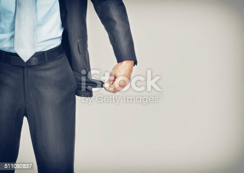 Cropped image of an unrecognizable businessman pulling out his empty pocket