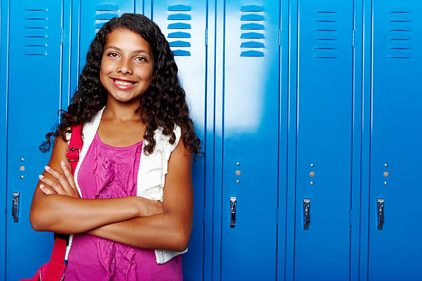 I'm excited about having the oppurtunity to learn! A cute young school girl standing at her locker getting ready to go into class - Copyspace cute middle school girls stock pictures, royalty-free photos & images