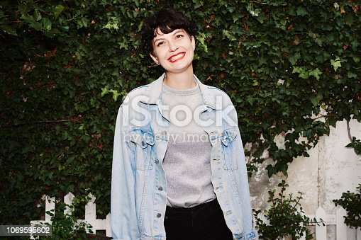 Portrait of an attractive young woman standing outdoors