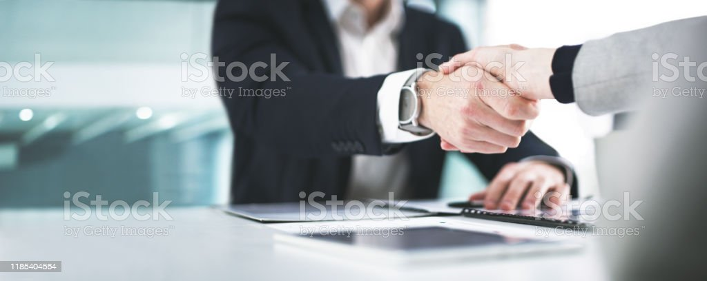 I'm glad we could settle on something Closeup shot of two businesspeople shaking hands in an office Adult Stock Photo