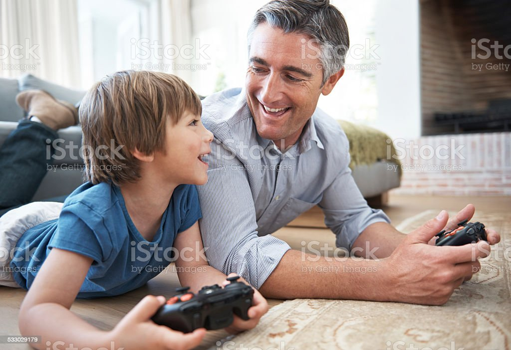 I'm going to beat you, Dad! stock photo