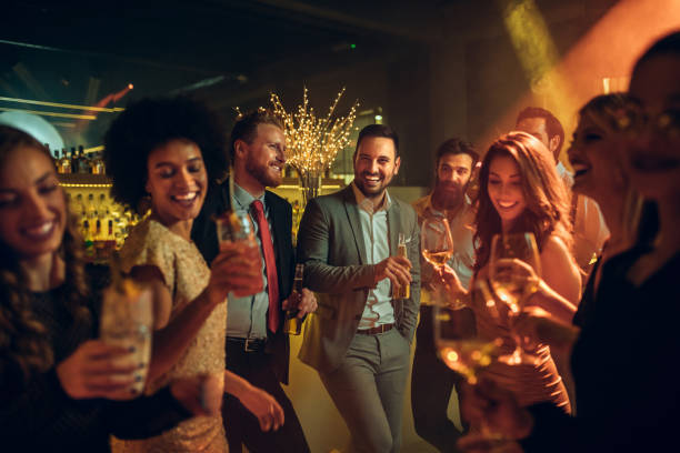 I'm having the best time with you guys! Group of friends partying at the nightclub grace stock pictures, royalty-free photos & images