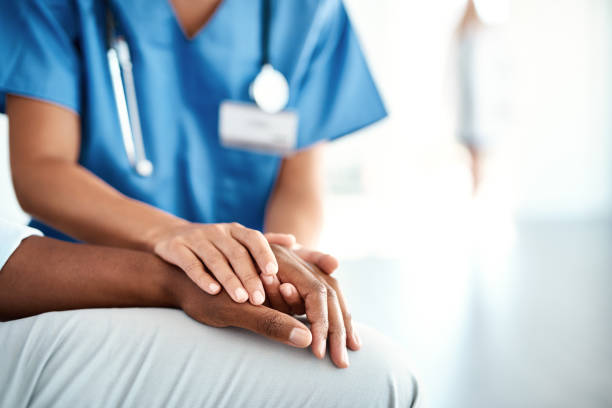 I'm here for you Cropped shot of an unrecognizable female nurse comforting a patient in the hospital healthcare and medicine stock pictures, royalty-free photos & images