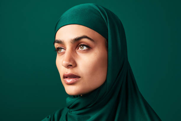 I'm in hijab and proud of it! Cropped shot of a beautiful young woman wearing a headscarf against a green background middle eastern ethnicity stock pictures, royalty-free photos & images