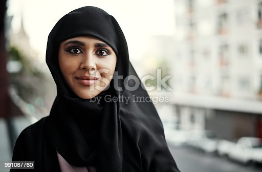 Cropped portrait of an attractive young businesswoman dressed in Islamic traditional clothing standing on her office balcony