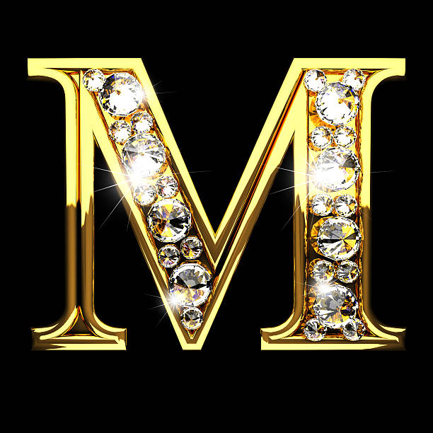 m isolated golden letters with diamonds on black stock photo