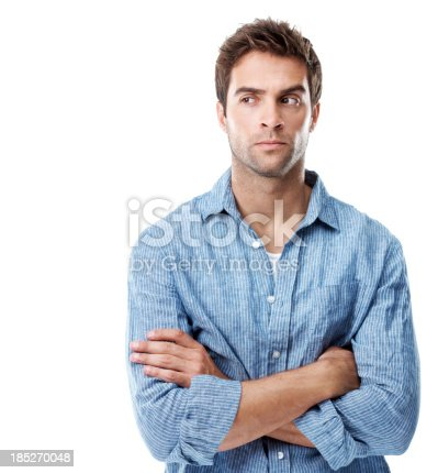 Handsome young man feeling suspicious while isolated on white