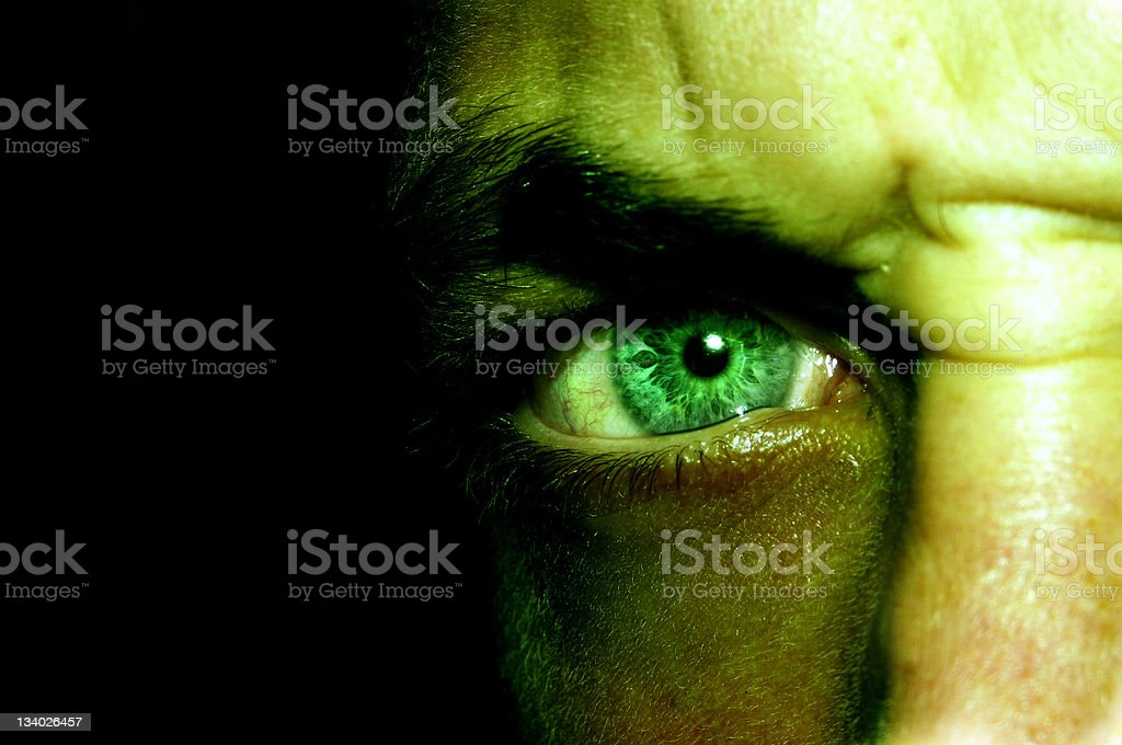 I'm no monster? picture of an eye, color adjusted so it looks like a mad man. Addiction Stock Photo