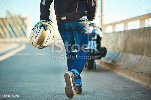 Shot of a young man riding a motorbike through the city
