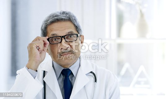 Cropped portrait of a handsome mature male doctor working in the hospital