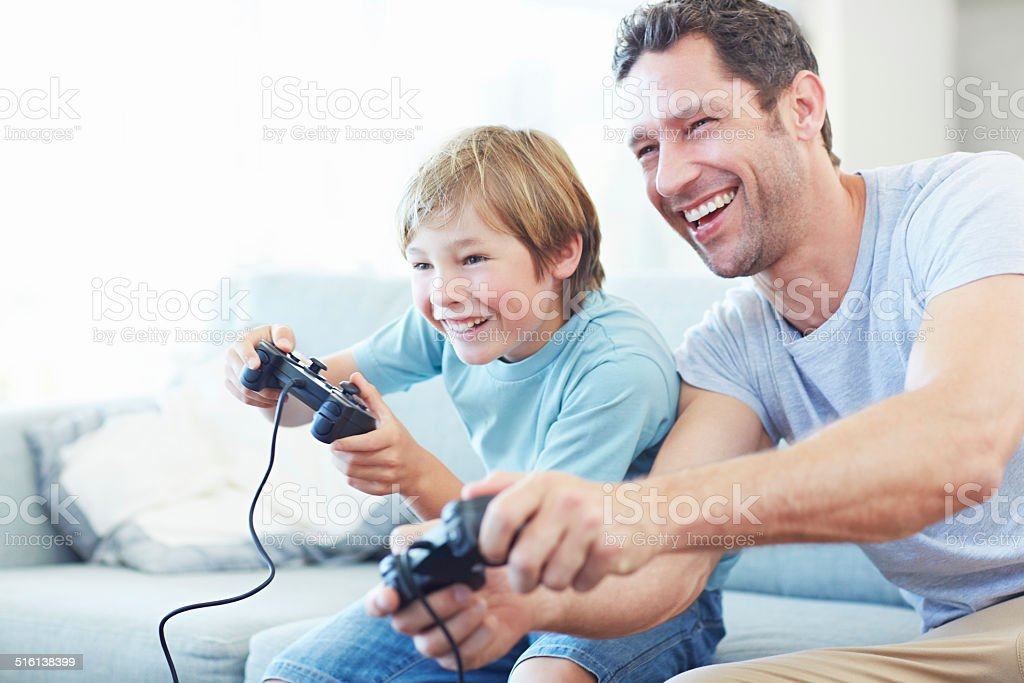 I'm so going to beat you dad! stock photo