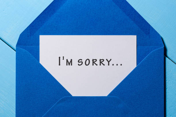 I'm SORRY - message in blue envelope I'm SORRY - message in blue envelope at wooden background apologist stock pictures, royalty-free photos & images