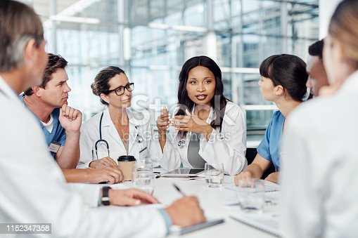 Cropped shot of a group of medical practitioners having a meeting in the boardroom