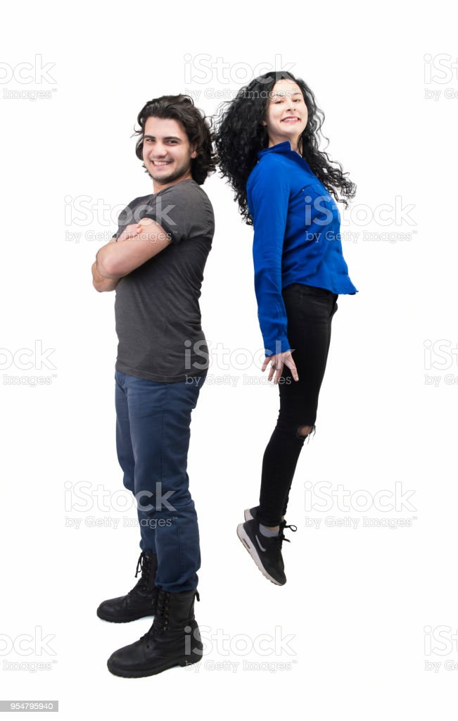 I'm taller than you! (Happy young couple enjoying on a white background) stock photo