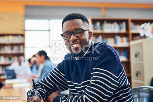 Portrait of a university student sitting in the library