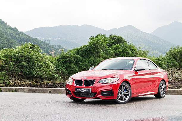 BMW M235i Engine on May 15 2014 in Hong Kong. Hong Kong, China - May 15, 2014 : BMW M235i Engine on May 15 2014 in Hong Kong. bmw stock pictures, royalty-free photos & images