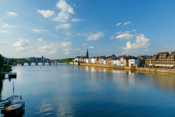 Maas River at Maastricht, Netherlands Maas River promenade with historic residential buildings along the river meuse river stock pictures, royalty-free photos & images