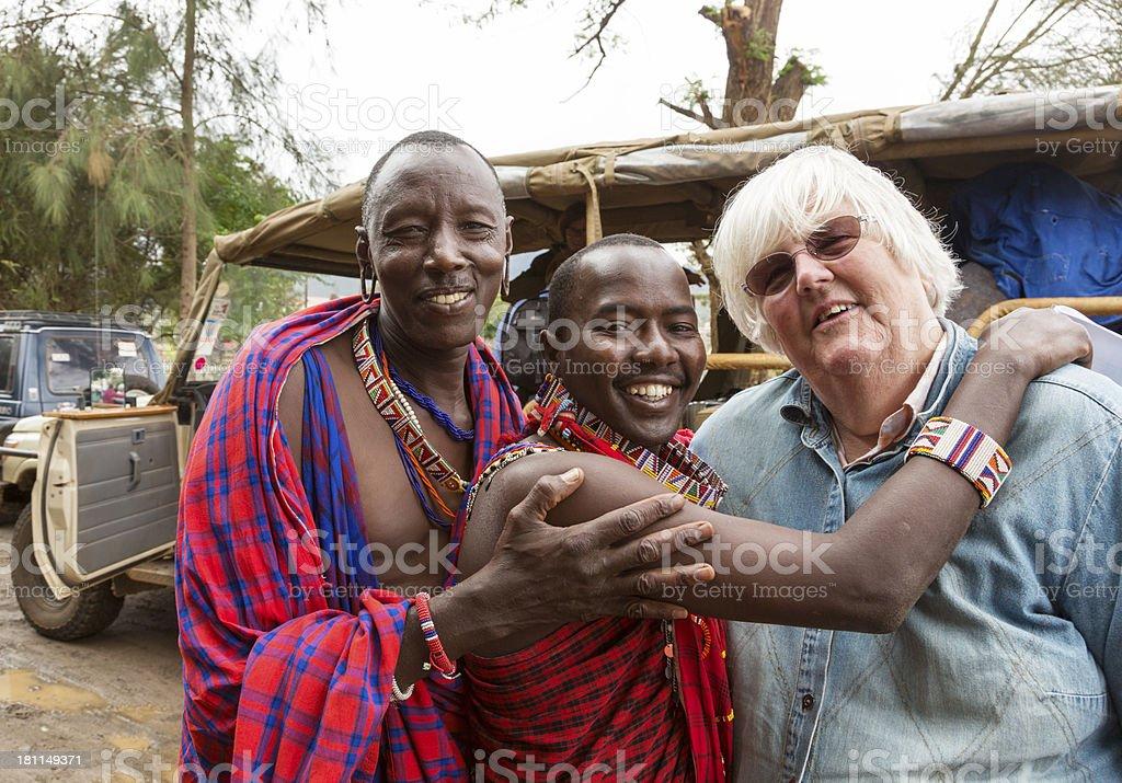 Maasai driver and guide saying goodbye to tourist. stock photo
