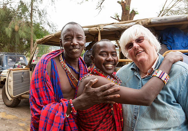 maasai driver and guide saying goodbye to tourist. - kenyan culture stock photos and pictures