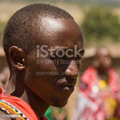 Maasai Mara , Kenya | October 18, 2007: Male portrait of Maasai man