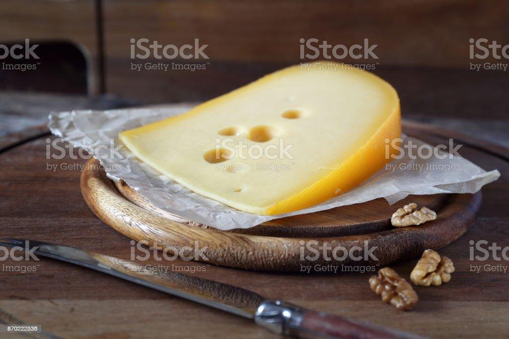 Maasdam cheese and walnuts stock photo