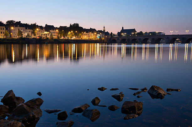 Maastricht across the river by night stock photo