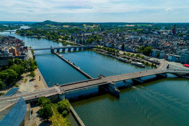maastricht aerial droneshot of the beautiful city maastricht, netherlands meuse river stock pictures, royalty-free photos & images