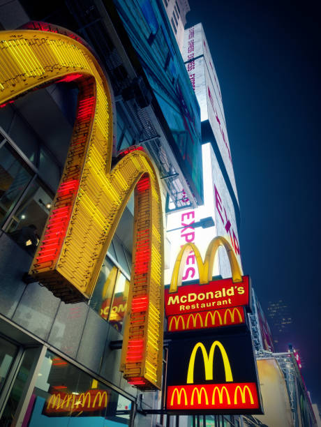 Mac Donald Logo at times square midtown at night stock photo