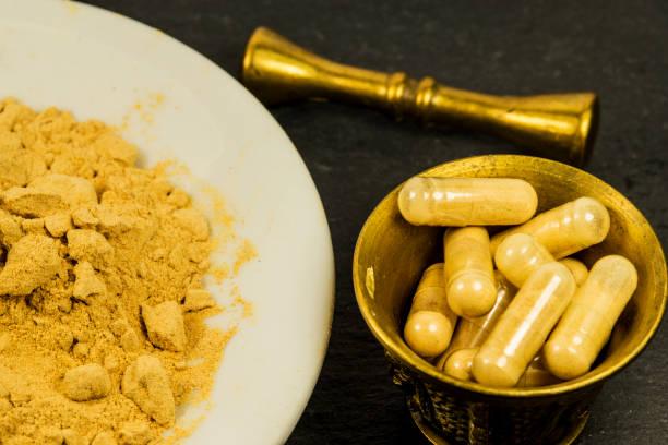 Maca, powder and capsules in a closeup stock photo