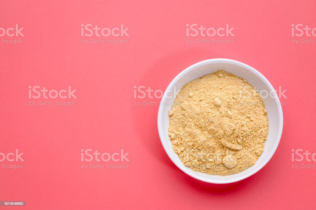 maca root powder in a bowl stock photo