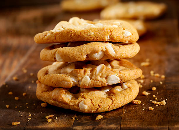 Macadamia Nut and White Chocolate Cookies Homemade Macadamia Nut and White Chocolate Cookies   -Photographed on Hasselblad H3D2-39mb Camera macadamia nut stock pictures, royalty-free photos & images