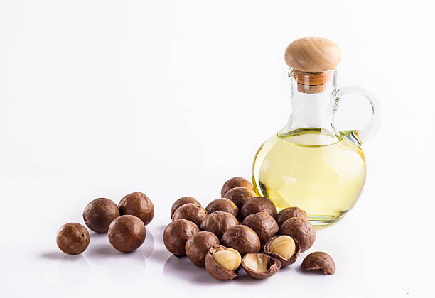 Macadamia oil Macadamia oil isolated on white background macadamia nut stock pictures, royalty-free photos & images