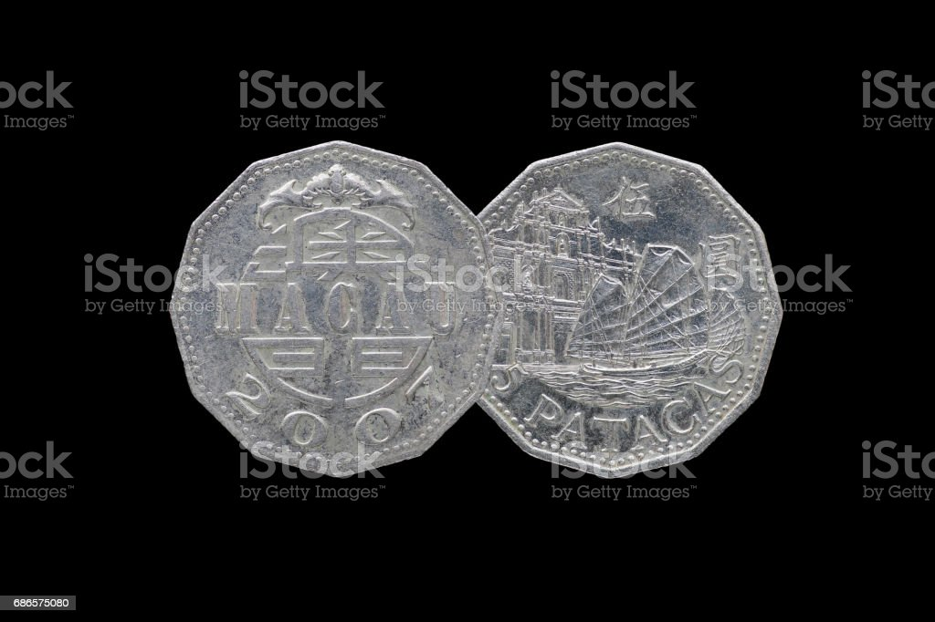 Macao 5 pataca coin year 2007 isolated on black background. royalty-free stock photo