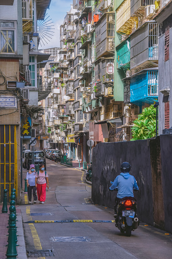 Macao, China - August 25, 2021: View to the urban street with short buildings at the sides in macao