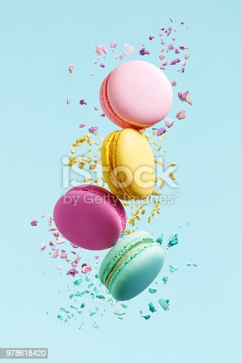 Macaron Dessert. Colorful Macaroons Flying. French Dessert In Motion Falling On Blue Background. High Resolution