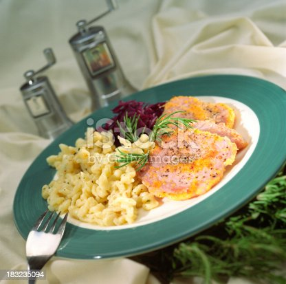 Plated Macaroni and cheese dish with Canadaian Bacon and side of shredded beats