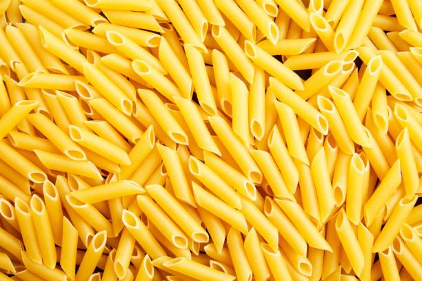 Macaroni background, Italian pasta. Ideal for publicity background stock photo