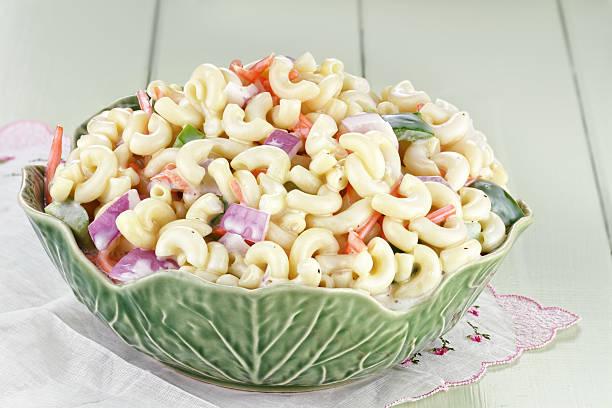 Macaroni Salad Macaroni salad with mayonnaise and vegetables. macaroni stock pictures, royalty-free photos & images