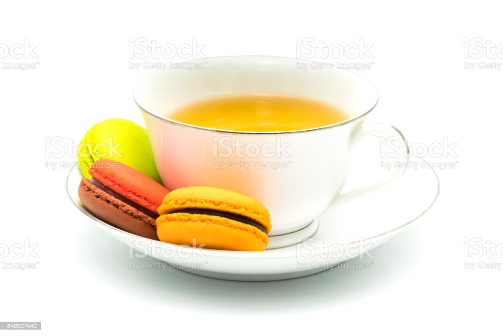 Macarons and a cup of tea stock photo