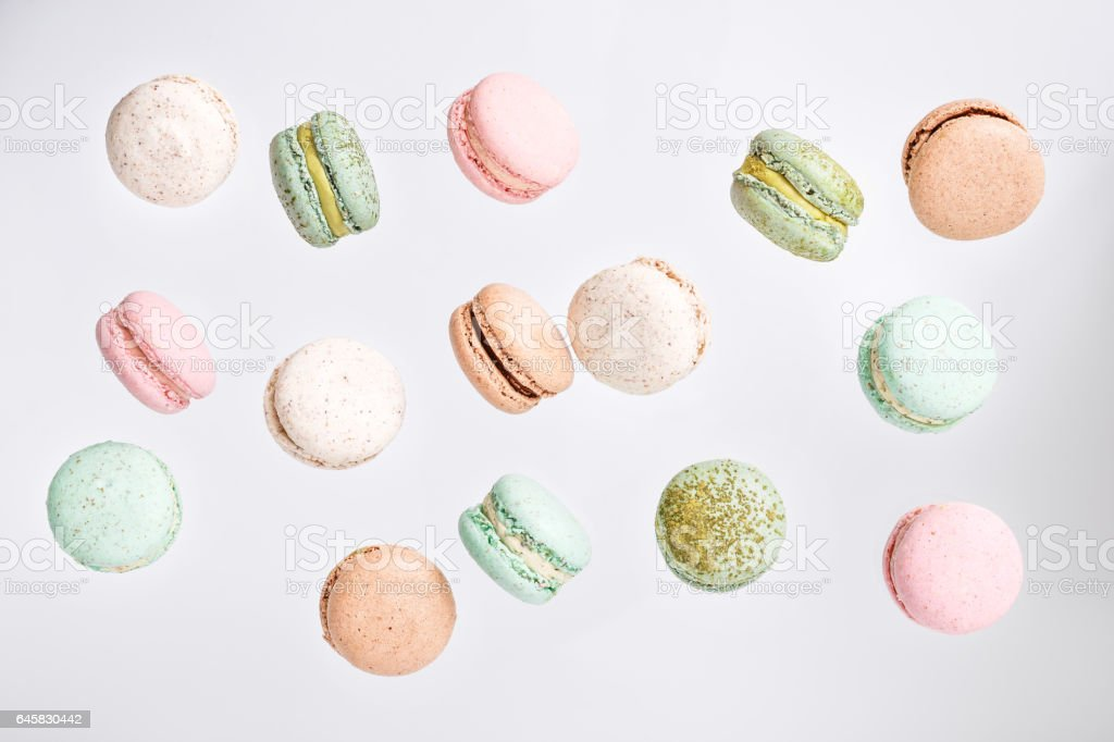 Macarons cake, top view flat lay, fly falling macaroon background