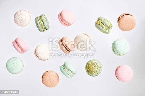 istock Macarons cake, top view flat lay, fly falling macaroon background 645830442