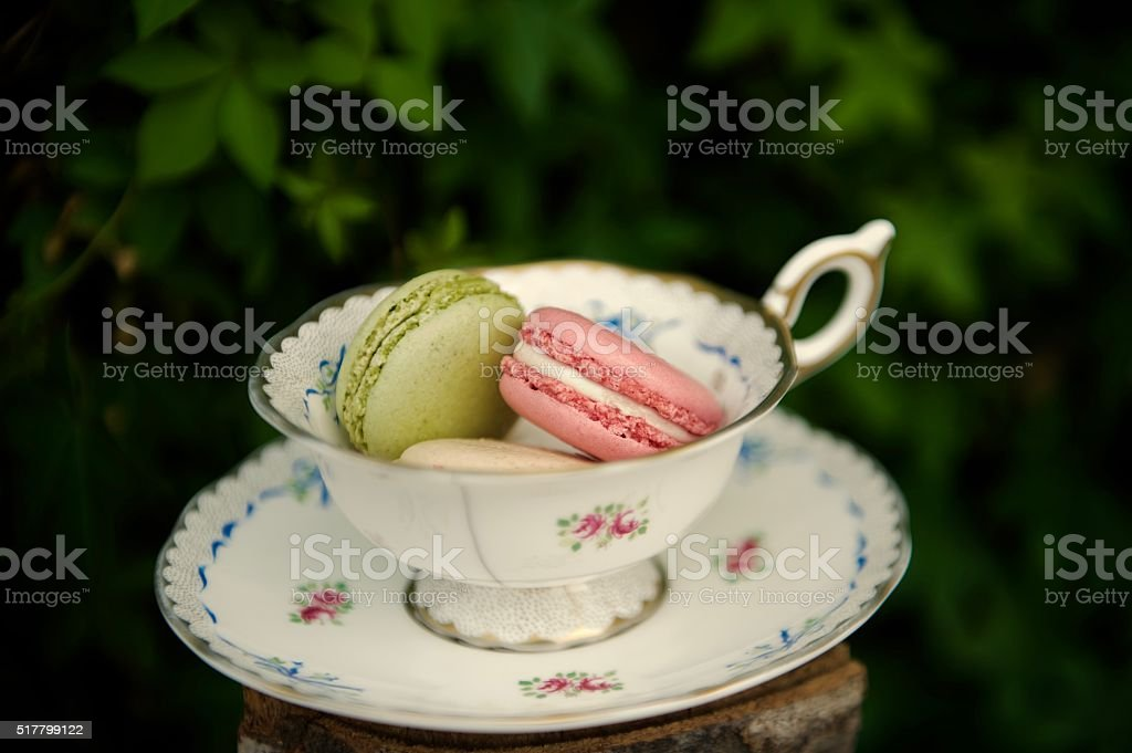 Macarons in a teacup stock photo