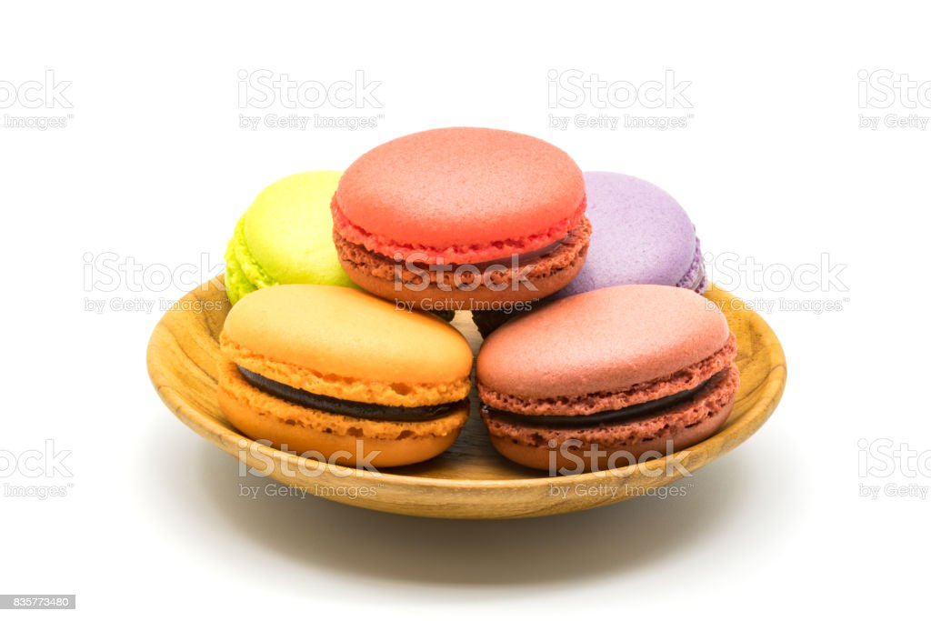 Macarons in wooden plate stock photo
