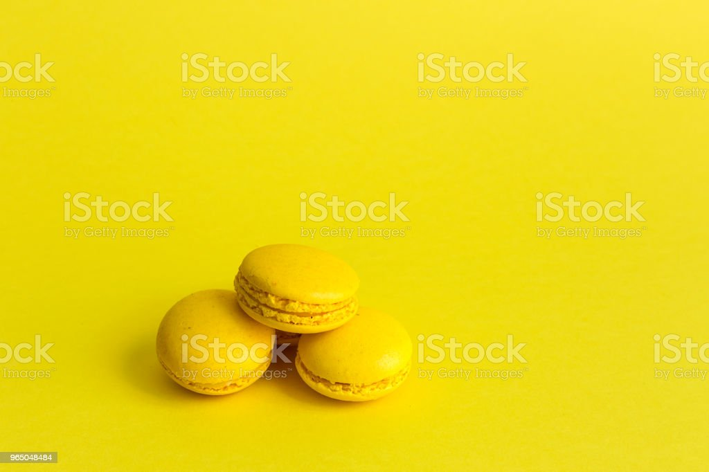 Macarons on yellow background royalty-free stock photo
