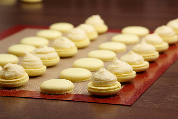 macaroon halves coated with cream macaroon halves coated with cream on blurred background silicon stock pictures, royalty-free photos & images